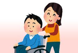 車椅子を押す女性のイメージ